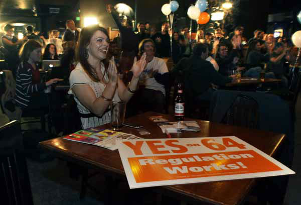 Amanda Jetter celebrates along with others attending an Amendment 64 watch party in a bar after a local television station announced the marijuana amendment&#39;s passage, in Denver, Colo., Tuesday, Nov. 6, 2012. The amendment would make it legal in Colorado for individuals to possess and for businesses to sell marijuana for recreational use. &#40;AP Photo&#47;Brennan Linsley&#41; <span class=meta>(AP Photo&#47; Brennan Linsley)</span>