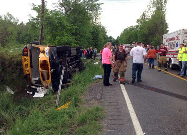 In this photo provided by the Kentucky Transportation Cabinet, emergency crews respond to the scene of an overturned Union County school bus on U.S. 60 at Silver Mine Road near Smithland, Ky., Friday, May 10, 2013. The bus was carrying the Union County High School girls&#39; softball team and had 28 people aboard when it overturned. 25 of those on board were taken to local hospitals with non-life threatening injuries. State Police Trooper Richie Wright said one patient was airlifted from the scene, but it was not due to serious injuries. &#40;AP Photo&#47;Kentucky Transportation Cabinet&#41; <span class=meta>(AP Photo&#47; Uncredited)</span>