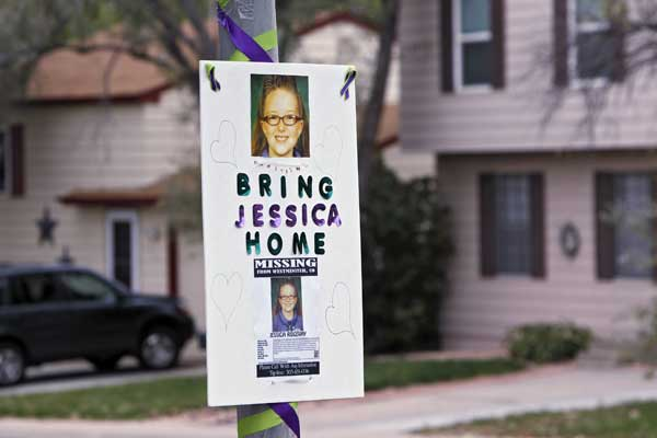 A missing person sign is posted on a lamp post near the home of ten-year-old Jessica Ridgeway where police continue to search for the missing girl in Westminster, Colo., on Wednesday, Oct. 10, 2012. The youngster has been missing since she left her home Friday morning on her way to school.   <span class=meta>(AP Photo&#47;Ed Andrieski)</span>