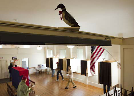 "<div class=""meta ""><span class=""caption-text "">A stuffed loon overlooks voters in the Old Town Hall, Tuesday, Nov. 6, 2012, on Westport Island, Maine. (AP Photo/Robert F. Bukaty) (AP Photo/ Robert F. Bukaty)</span></div>"