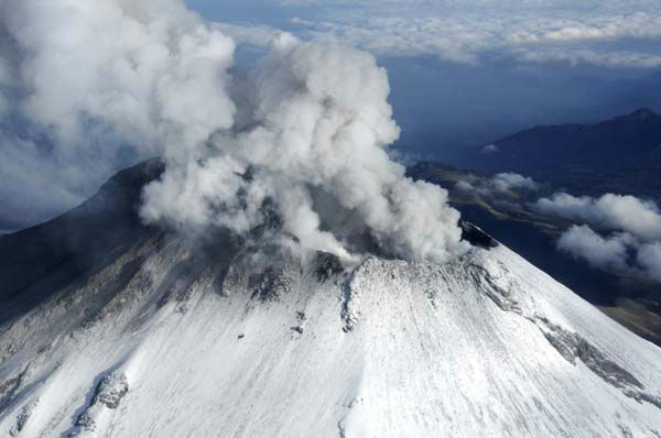 In this image released by the Mexican Navy &#40;SEMAR&#41;, steam and ash rise from the crater of the Popocatepetl volcano on the outskirts of Mexico City as seen during an over flight on Wednesday, July 10, 2013.  Last Saturday, Mexico&#39;s National Center for Disaster Prevention raised the volcano alert from Stage 2 Yellow to Stage 3 Yellow, the final step before a Red alert, when possible evacuations could be ordered after the Popocatepetl volcano spit out a cloud of ash and vapor 2 miles &#40;3 kilometers&#41; high over several days of eruptions. &#40;AP Photo&#47;SEMAR&#41; <span class=meta>(AP Photo&#47; SEMAR)</span>