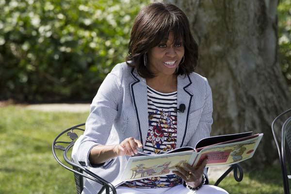 First lady Michelle Obama reads the book &#34;Cloudy With A Chance of Meatballs&#34; to children as part of the annual White House Easter Egg Roll, Monday, April 1, 2013 on the South Lawn of the White House in Washington. &#40;AP Photo&#47;Jacquelyn Martin&#41; <span class=meta>(AP Photo&#47; Jacquelyn Martin)</span>