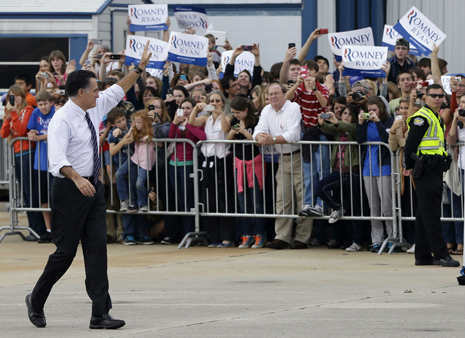 "<div class=""meta ""><span class=""caption-text "">Republican presidential candidate, former Massachusetts Gov. Mitt Romney waves to supporters as he walks back to his plane after a Florida campaign rally at Orlando Sanford International Airport, in Sanford, Fla., Monday, Nov. 5, 2012. (AP Photo/Charles Dharapak) (AP Photo/ Charles Dharapak)</span></div>"