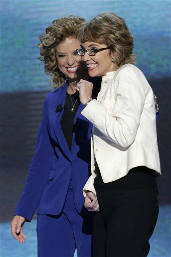 Former Rep. Gabrielle Giffords reacts after reciting the Pledge of Allegiance with Democratic National Committee Chairwoman Rep. Debbie Wasserman Schultz of Florida at the Democratic National Convention in Charlotte, N.C., on Thursday, Sept. 6, 2012. &#40;AP Photo&#47;J. Scott Applewhite&#41; <span class=meta>(AP Photo&#47; J. Scott Applewhite)</span>