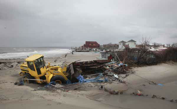 A front end loader clears debris caught in floods and washed onto the beach near the Seaview community in the aftermath of superstorm Sandy on Tuesday, Oct. 30, 2012, in Coney Island, N.Y.  &#40;AP Photo&#47;Bebeto Matthews&#41; <span class=meta>(AP Photo&#47; Bebeto Matthews)</span>