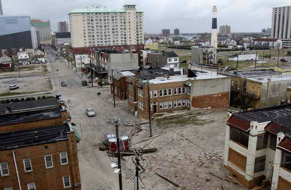 "<div class=""meta ""><span class=""caption-text "">Sand and debris covers the streets near the water in Atlantic City, N.J., Tuesday, Oct. 30, 2012. Sandy, the storm which was downgraded from a hurricane just before making landfall, caused multiple fatalities, halted mass transit and cut power to more than 6 million homes and businesses. (AP Photo/Seth Wenig) (AP Photo/ Seth Wenig)</span></div>"