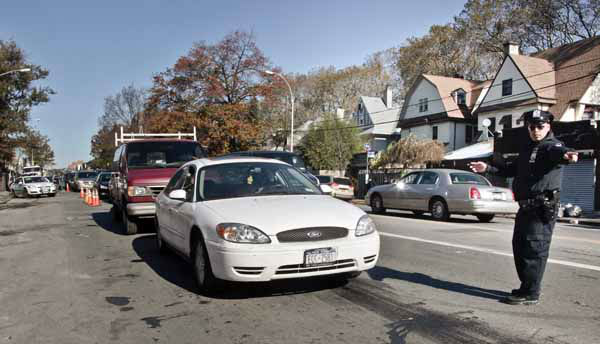 Police direct cars in line to gas station pumps on Friday, Nov. 9, 2012 in Brooklyn, N.Y.  Police were at gas stations to enforce a new gasoline rationing plan that lets motorists fill up every other day that started in New York on Friday morning. &#40;AP Photo&#47;Bebeto Matthews&#41; <span class=meta>(AP Photo&#47; Bebeto Matthews)</span>