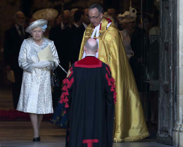 "<div class=""meta ""><span class=""caption-text "">Britain's Queen Elizabeth II escorted by the Dean of  Westminster Abbey, Dr John Hall,  leaves through the west door after a service to celebrate the 60th anniversary of her coronation at Westminster Abbey, London, Tuesday, June  4, 2013. (AP Photo/Alastair Grant) (AP Photo/ Alastair Grant)</span></div>"