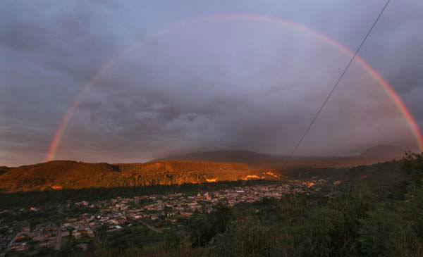 A rainbow forms over the town of Santiago Xalizintla where the Popocatepetl volcano, behind center, is covered by clouds in Mexico, Monday, July 8, 2013. The Environment Ministry has urged residents to take preventive measures to deal with the ash, including wearing dust masks, covering water supplies and staying indoors as needed. &#40;AP Photo&#47;Marco Ugarte&#41; <span class=meta>(AP Photo&#47; Marco Ugarte)</span>