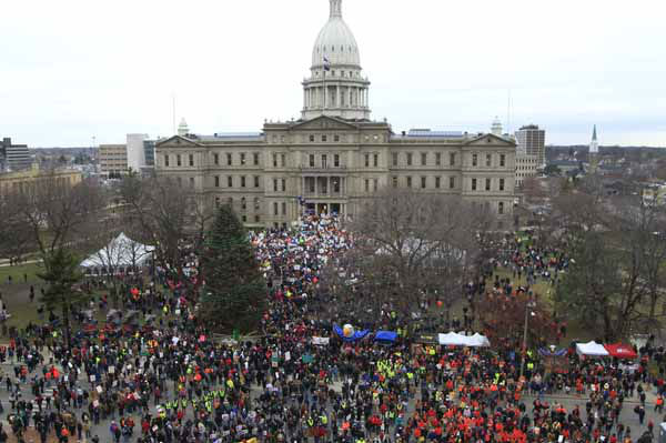 "<div class=""meta ""><span class=""caption-text "">Thousands of supporters rally at the State Capitol grounds in Lansing, Mich., Tuesday, Dec. 11, 2012. The crowd is protesting right-to-work legislation that was passed by the state legislature last week. (AP Photo/Carlos Osorio) (AP Photo/ Carlos Osorio)</span></div>"