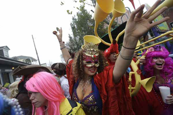 "<div class=""meta ""><span class=""caption-text "">Revelers gather for the start of the Society of Saint Anne walking parade in the Bywater section of New Orleans during Mardi Gras day, Tuesday, Feb. 12, 2013. FEMA markings from Hurricane Katrina are still seen on the wall. (AP Photo/Gerald Herbert)</span></div>"