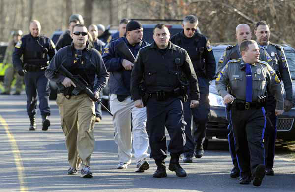 "<div class=""meta ""><span class=""caption-text "">Law enforcement canvass the area following a shooting at the Sandy Hook Elementary School in Newtown, Conn., about 60 miles (96 kilometers) northeast of New York City, Friday, Dec. 14, 2012. An official with knowledge of Friday's shooting said 27 people were dead, including 18 children.  (AP Photo/Jessica Hill) (AP Photo/ Jessica Hill)</span></div>"