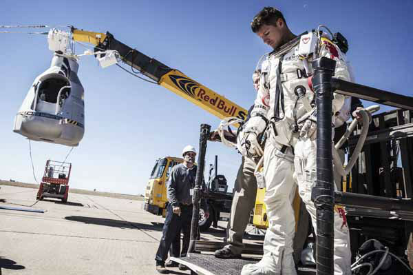 In this photo provided by Red Bull Stratos, pilot Felix Baumgartner of Austria leaves his capsule after his mission was aborted due to high winds during the final manned flight of Red Bull Stratos in Roswell, N.M., Tuesday, Oct. 9, 2012.?&#40;AP Photo&#47;Red Bull Stratos, Balazs Gardi&#41; <span class=meta>(AP Photo&#47; Balazs Gardi)</span>