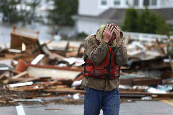 Brian Hajeski, 41, of Brick, N.J., reacts after looking at debris of a home that washed up on to the Mantoloking Bridge the morning after superstorm Sandy rolled through, Tuesday, Oct. 30, 2012, in Mantoloking, N.J. Sandy, the storm that made landfall Monday, caused multiple fatalities, halted mass transit and cut power to more than 6 million homes and businesses. &#40;AP Photo&#47;Julio Cortez&#41; <span class=meta>(AP Photo&#47; Julio Cortez)</span>