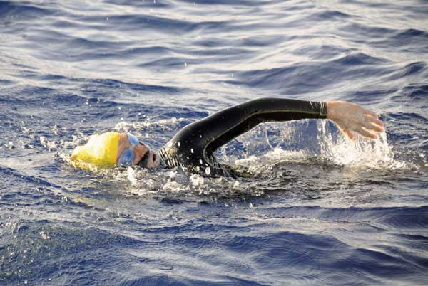 "<div class=""meta ""><span class=""caption-text "">In this photo provided by Diana Nyad via the Florida Keys News Bureau, endurance swimmer Diana Nyad swims in the Florida Straits between Cuba and the Florida Keys Sunday, Aug. 19, 2012. Nyad is endeavoring to become the first swimmer to transit the Florida Straits from Cuba to the Keys without a shark cage.  (AP Photo/Diana Nyad via the Florida Keys News Bureau, Christi Barli)</span></div>"