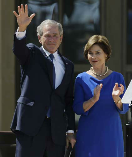 Former president George W. Bush waves with  his wife Laura speech during the dedication of the George W. Bush Presidential Center Thursday, April 25, 2013, in Dallas. &#40;AP Photo&#47;David J. Phillip&#41; <span class=meta>(AP Photo&#47; David J. Phillip)</span>