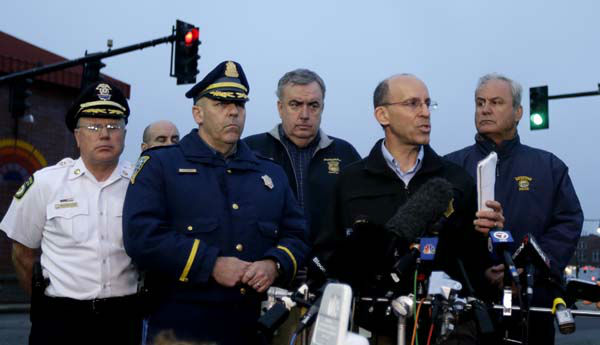 Boston area police talk at a press conference on Friday April 19 2013.  <span class=meta>(AP Photo&#47; Julio Cortez)</span>
