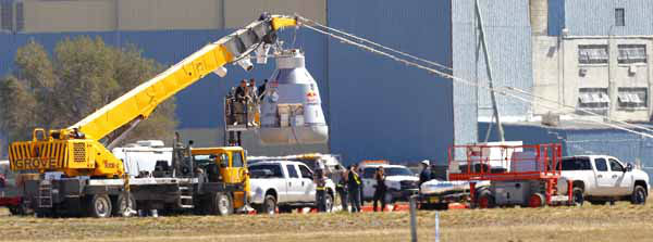 Felix Baumgartner disembarks from the balloon capsule after his mission was aborted in Roswell, N.M. on Tuesday, Oct. 9, 2012. Baumgartner was attempting to break the speed of sound with his own body by jumping from the capsule lifted 23 miles high by a 30 million cubic foot helium balloon. &#40;AP Photo&#47;Matt York&#41; <span class=meta>(AP Photo&#47; Matt York)</span>