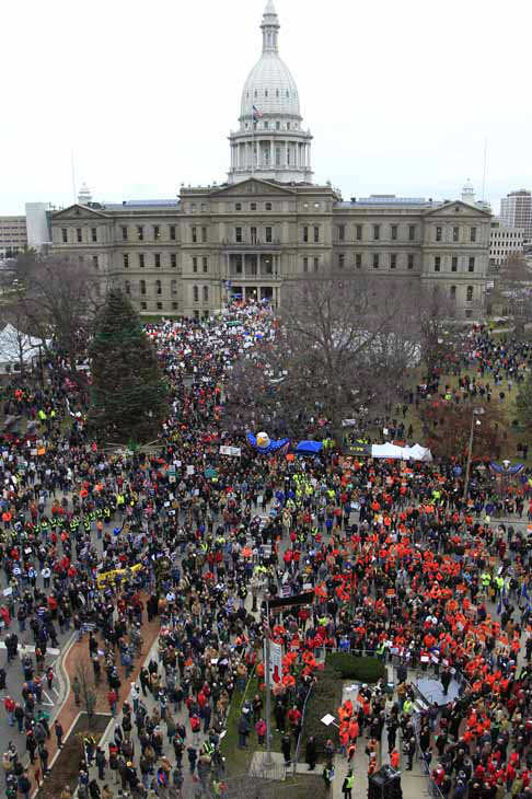 Thousands of supporters rally at the State Capitol grounds in Lansing, Mich., Tuesday, Dec. 11, 2012. The crowd is protesting right-to-work legislation that was passed by the state legislature last week. &#40;AP Photo&#47;Carlos Osorio&#41; <span class=meta>(AP Photo&#47; Carlos Osorio)</span>