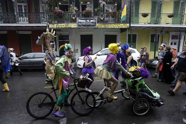 Rivelers pass a sign critical of NFL Commissioner Roger Goodell during Mardi Grasin the French Quarter  in New Orleans, Tuesday, Feb. 12, 2013. &#40;AP Photo&#47;Gerald Herbert&#41; <span class=meta>(AP Photo&#47; Gerald Herbert)</span>