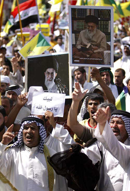 Iraqis chant slogans as they hold posters of Iran&#39;s supreme leader Ayatollah Khamenei, while chanting &#34;death to America,&#34; and &#34;no to America,&#34; during a protest in Basra, 340 miles &#40;547 kilometers&#41; southeast of Baghdad, Iraq, Friday, Sept. 21, 2012, as part of widespread anger across the Muslim world about a film ridiculing Islam&#39;s Prophet Muhammad. The Arabic placard reads, &#34;oh messenger of Allah.&#34; &#40;AP Photo&#47;Nabil al-Jurani&#41; <span class=meta>(AP Photo&#47; Nabil al-Jurani)</span>