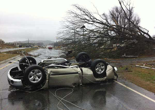 A vehicle lies on a road after a tornado moved through Adairsville, Ga. on Wednesday, Jan. 30, 2013. A fierce storm system that roared across northwest Georgia has left at least one person dead and a trail of damage that included demolished buildings in downtown Adairsville and vehicles overturned on Interstate 75 northwest of Atlanta. &#40;AP Photo&#47;David Goldman&#41; <span class=meta>(AP Photo&#47; David Goldman)</span>