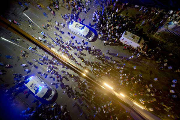 "<div class=""meta ""><span class=""caption-text "">Ambulances stand by to evacuate injured protesters after riot police flooded the Gazi Park with tear gas during clashes at the Taksim Square in Istanbul Tuesday, June 11, 2013. Hundreds of police in riot gear forced through barricades in the square early Tuesday, pushing many of the protesters who had occupied the square for more than a week into a nearby park. (AP Photo/Vadim Ghirda) (AP Photo/ Vadim Ghirda)</span></div>"