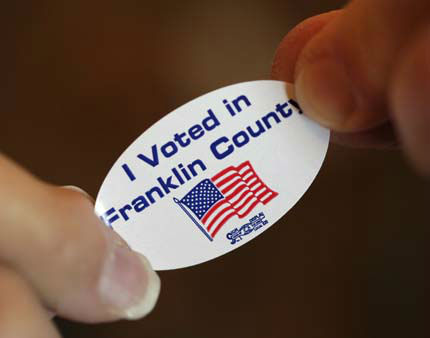 A voter is handed an &#34;I Voted&#34; sticker after casting her ballot at the old Brown School Tuesday, Nov. 6, 2012, in rural Wellsville, Kan. &#40;AP Photo&#47;Charlie Riedel&#41; <span class=meta>(AP Photo&#47; Charlie Riedel)</span>