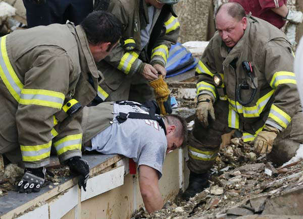 Rescue workers dig through the rubble of a collapsed wall at the Plaza Tower Elementary School to free trapped students in Moore, Okla., following a tornado Monday, May 20, 2013. A tornado as much as a mile &#40;1.6 kilometers&#41; wide with winds up to 200 mph &#40;320 kph&#41; roared through the Oklahoma City suburbs Monday, flattening entire neighborhoods, setting buildings on fire and landing a direct blow on an elementary school. &#40;AP Photo Sue Ogrocki&#41; <span class=meta>(AP Photo&#47; Sue Ogrocki)</span>