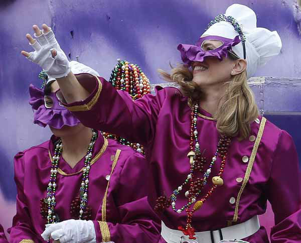 A mask rider in the Iris Mardi Gras parade waves from the float as it rolls through the streets of New Orleans,  Saturday, Feb. 9, 2013.&#40;AP Photo&#47;Bill Haber&#41; <span class=meta>(AP Photo&#47; Bill Haber)</span>