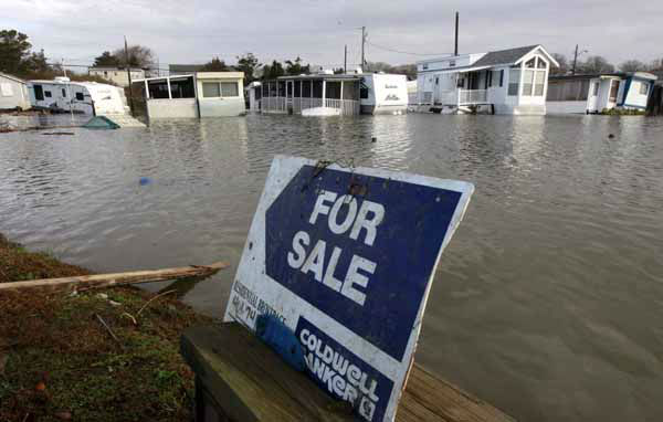 A for sale sign sits near flooded trailer homes in South Kingstown, R.I., Tuesday, Oct. 30, 2012. Beach cottages were destroyed, businesses were flooded and a quarter of the state was without power Tuesday after superstorm Sandy blew through Rhode Island. &#40;AP Photo&#47;Steven Senne&#41; <span class=meta>(AP Photo&#47; Steven Senne)</span>