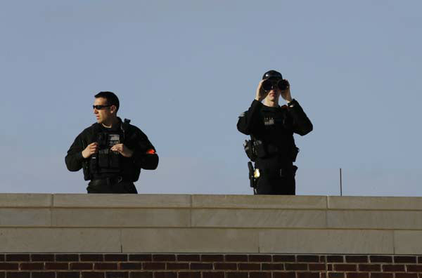 Secret Service officers keep watch from a rooftop as guests arrive for the dedication of the George W. Bush Presidential Center Thursday, April 25, 2013, in Dallas. &#40;AP Photo&#47;David J. Phillip&#41; <span class=meta>(AP Photo&#47; David J. Phillip)</span>