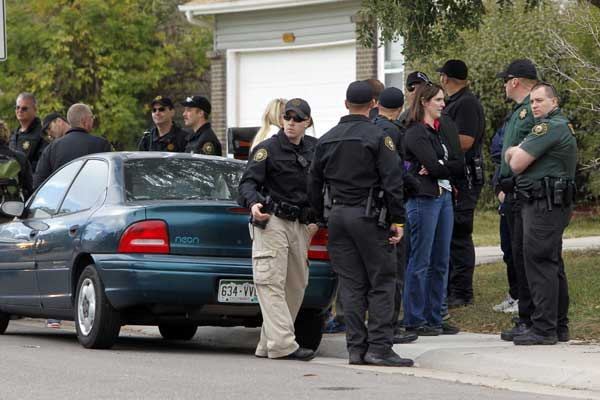 Police gather after canvassing a neighborhood looking for clues in the search for ten-year-old Jessica Ridgeway near her home in Westminster, Colo., on Wednesday, Oct. 10, 2012. The youngster has been missing since she left her home Friday morning on her way to school.  <span class=meta>(AP Photo&#47;Ed Andrieski)</span>