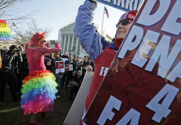 Qween Amar from Orlando, Fla., left, dances by Margie Phelps, right, a member of the Westboro Baptist Church, outside the Supreme Court in Washington, Tuesday, March 26, 2013, where the court will hear arguments on California?s voter approved ban on same-sex marriage, Proposition 8. &#40;AP Photo&#47;Pablo Martinez Monsivais&#41; <span class=meta>(AP Photo&#47; Pablo Martinez Monsivais)</span>