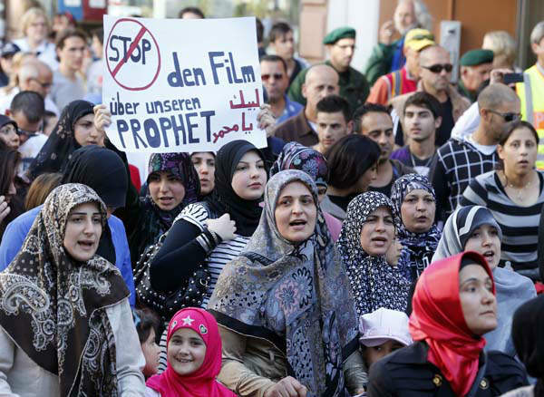 "<div class=""meta ""><span class=""caption-text "">Muslims demonstrate against an anti-Muslim film in downtown Freiburg, Germany, Friday, Sept. 21, 2012. Banner reads: ""Stop the Movie against our Prophet"". (AP Photo/Michael Probst) (AP Photo/ Michael Probst)</span></div>"