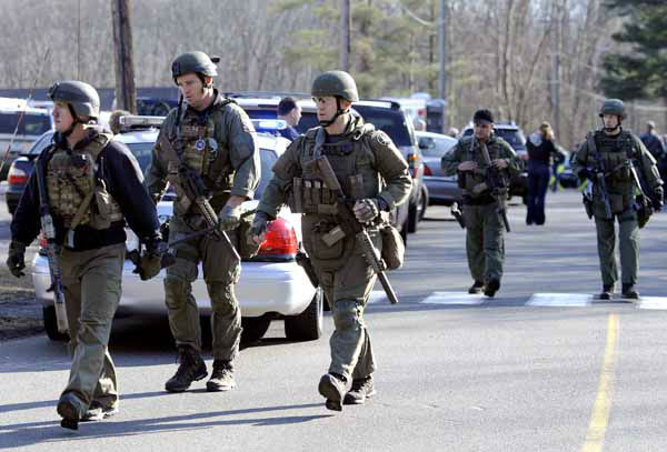 State Police are on scene following a shooting at the Sandy Hook Elementary School in Newtown, Conn., about 60 miles &#40;96 kilometers&#41; northeast of New York City, Friday, Dec. 14, 2012. An official with knowledge of Friday&#39;s shooting said 27 people were dead, including 18 children. &#40;AP Photo&#47;Jessica Hill&#41; <span class=meta>(AP Photo&#47; Jessica Hill)</span>