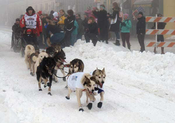 Defending champion Dallas Seavey takes off Saturday, March 2, 2013, in downtown Anchorage, Alaska, for the ceremonial start of the 2013 Iditarod Trail Sled Dog Race. The race, which will take mushers and dog teams about a thousand miles across the Alaska wilderness, starts Sunday, March 3, 2013, in Willow, Alaska. &#40;AP Photo&#47;Mark Thiessen&#41; <span class=meta>(AP Photo&#47; Mark Thiessen)</span>