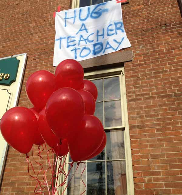 "<div class=""meta ""><span class=""caption-text "">A homemade sign written on a table cloth, hangs outside the Stone River Grille, in honor of the teachers who died along with students a day earlier when a gunman open fire at Sandy Hook Elementary School, Saturday, Dec. 15, 2012, in the Sandy Hook village of Newtown, Conn. Gary Seri, general manager at the Stone River Grille, put up red balloons that were not used when a sweet 16 party was canceled the night before in light of the massacre, said the teachers were scheduled to have their holiday party at his restaurant. The massacre of 26 children and adults at Sandy Hook Elementary school elicited horror and soul-searching around the world even as it raised more basic questions about why the gunman, 20-year-old Adam Lanza, would have been driven to such a crime and how he chose his victims. (AP Photo/Allen Breed)</span></div>"