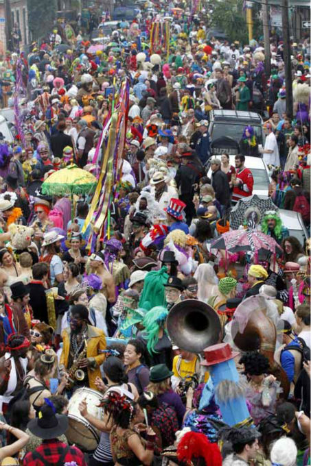 "<div class=""meta image-caption""><div class=""origin-logo origin-image ""><span></span></div><span class=""caption-text"">Revelers gather for the start of the Society of Saint Anne walking parade in the Bywater section of New Orleans during Mardi Gras day, Tuesday, Feb. 12, 2013.  Overcast skies and the threat of rain couldn't dampen the revelry of Mardi Gras as parades took to the streets, showering costumed merrymakers with trinkets of all kinds.  (AP Photo/Gerald Herbert) (AP Photo/ Gerald Herbert)</span></div>"