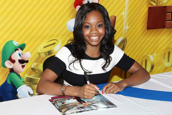 This image released by Starpix shows Olympic gymnast Gabrielle Douglas  at an autograph-signing event at the Nintendo World Store in Rockefeller Center, Tuesday, Sept. 25, 2012 in New York. &#40;AP Photo&#47;Starpix, Kristina Bumphrey&#41; <span class=meta>(AP Photo&#47; Kristina Bumphrey)</span>