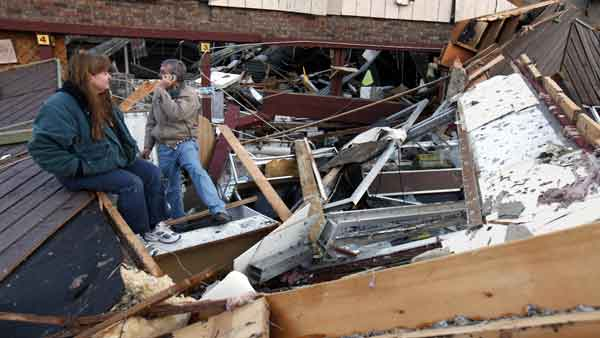 Sherry Cousins and her brother Bruce Wallace of Hollister, Mo., sit in the wreckage of their secondhand store in Branson, Mo, Wednesday, Feb. 29, 2012.  <span class=meta>(AP)</span>