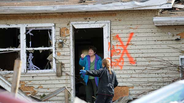 Margaret Shimkus, 61, talks with an emergency responder about her condition Wednesday, Feb. 29, 2012, at her home in Harrisburg, Ill., after an early morning tornado ripped through the town.  <span class=meta>(AP)</span>