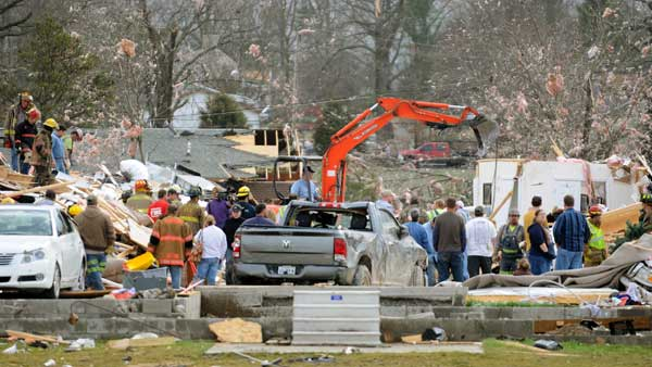 Emergency responders work to clear debris in a neighborhood in Harrisburg, Ill., after an early morning tornado Wednesday, Feb. 29, 2012. <span class=meta>(AP)</span>