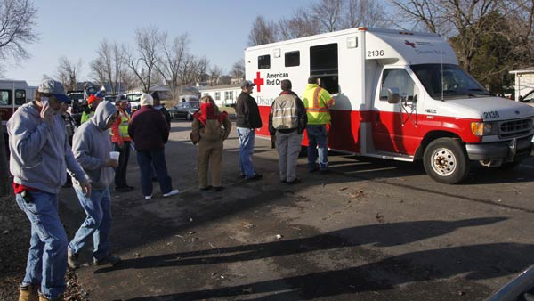 "<div class=""meta ""><span class=""caption-text "">Residents and volunteers line up for food and drink, the morning after severe storms destroyed several homes and businesses in Harveyville, Kan. February 29, 2012.  (AP)</span></div>"