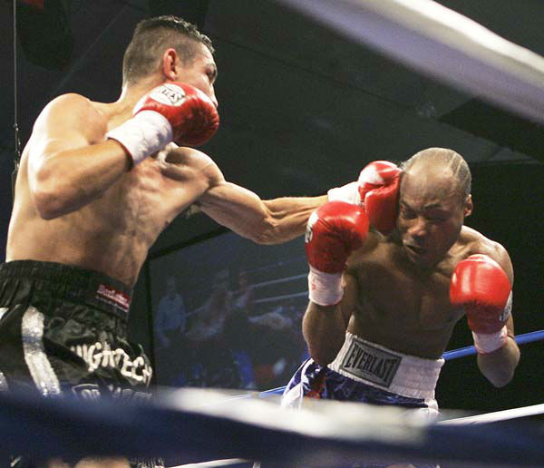 Humberto Toledo, right, of Ecuador, is knocked down for the second time by Humberto Soto, of Mexico, in the third round of a boxing match in Chester, W.Va., Thursday, Feb. 22, 2007. Soto knocked out Toledo in the third round. &#40;AP Photo&#47;Keith Srakocic&#41; <span class=meta>(AP Photo&#47; Keith Srakocic)</span>