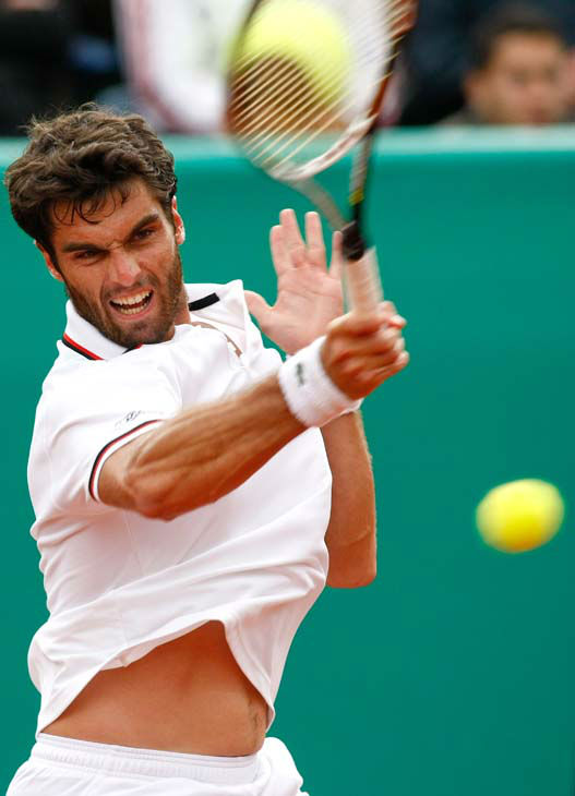 Spain&#39;s Pablo Andujar returns the ball to Spain&#39;s Albert Ramos  during the final of the Grand Prix Hassan II tennis tournament in Casablanca, Morocco, Sunday, April 15, 2012. Andujar won 6-1, 7-6 &#40;7-5&#41;. &#40;AP Photo&#47;Abdeljalil Bounhar&#41; <span class=meta>(AP Photo&#47; ABDELJALIL BOUNHAR)</span>