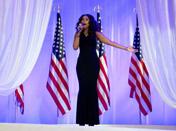 Jennifer Hudson sings as President Barack Obama and first lady Michelle Obama dance together at an Inaugural Ball, Monday, Jan. 21, 2013, at the Washington Convention Center in Washington, during the 57th Presidential Inauguration.  <span class=meta>(AP Photo&#47;Carolyn Kaster)</span>