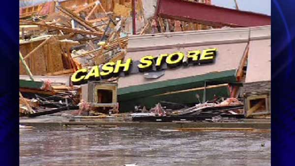 A Cash Store falls to the ground in Harrisburg, Ill., after an early morning tornado Wednesday, Feb. 29, 2012  <span class=meta>(ABC 7 Chicago)</span>