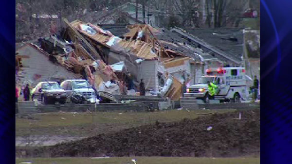 Emergency responders help pick up debris after an early morning tornado in Harrisburg, Ill.,Wednesday, Feb. 29, 2012 <span class=meta>(ABC 7 Chicago)</span>