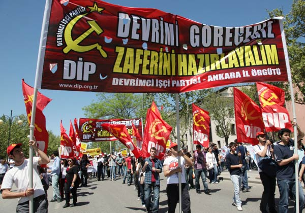 "Thousands of people march during a May Day rally in Turkish capital, Ankara,, Turkey, Tuesday, May 1, 2012 The banner reads: "" We will see the revolution. Let's get ready to celebrate.""(AP Photo/Burhan Ozbilici)"